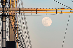 "© Licensed to London News Pictures; 06/05/2020; Bristol, UK. The ""Flower Moon"" the last supermoon this spring is seen over Bristol Docks and the ship the SS Great Britain which also has a ""Thank you NHS"" banner displayed in front of the ship to thank the NHS for their work during the Covid-19 coronavirus pandemic. Launched in 1843 the SS Great Britain was the longest passenger ship in the world from 1845 to 1854. She was designed by Isambard Kingdom Brunel, for the Great Western Steamship Company's transatlantic service between Bristol and New York City. While other ships had been built of iron or equipped with a screw propeller, the Great Britain was the first to combine these features in a large ocean-going ship. Photo credit: Simon Chapman/LNP."