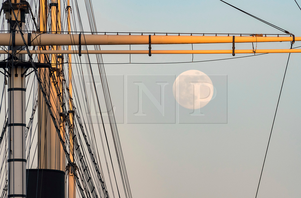 """© Licensed to London News Pictures; 06/05/2020; Bristol, UK. The """"Flower Moon"""" the last supermoon this spring is seen over Bristol Docks and the ship the SS Great Britain which also has a """"Thank you NHS"""" banner displayed in front of the ship to thank the NHS for their work during the Covid-19 coronavirus pandemic. Launched in 1843 the SS Great Britain was the longest passenger ship in the world from 1845 to 1854. She was designed by Isambard Kingdom Brunel, for the Great Western Steamship Company's transatlantic service between Bristol and New York City. While other ships had been built of iron or equipped with a screw propeller, the Great Britain was the first to combine these features in a large ocean-going ship. Photo credit: Simon Chapman/LNP."""