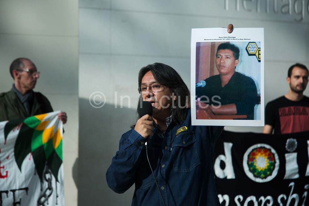 Gilberto Torres hold up pictures of missing friends and colleagues, here it is Aury Sara Marrugo who was murdered in 2001. The political activist theatre group BP-or-not-BP target the British Museum for taking sponsorship from the oil company BP. The group wants the museum to drop their sponsorship deal with BP. With them on stage is Gilberto Torres, from Colombia , who is taking BP to court over his kidnap and torture in Colombia in 2002 when he was a union representative.