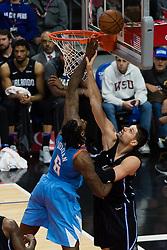 March 10, 2018 - Los Angeles, CA, U.S. - LOS ANGELES, CA - MARCH 10: Orlando Magic center Nikola Vucevic (9) gets a hand on LA Clippers center DeAndre Jordan (6) as he goes up for a rebound during the game between the Orlando Magic and the LA Clippers on March 10, 2018, at STAPLES Center in Los Angeles, CA. (Photo by David Dennis/Icon Sportswire) (Credit Image: © David Dennis/Icon SMI via ZUMA Press)