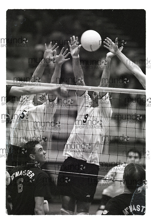 """If you wish to purchase this image, please contact us at info@mundosportimages.com quoting file name """"19961106_SB_UWOb&W_102.JPG"""" and we will clean the image before sending preparing it for sale to you. This is one of several thousand """"raw"""" black and white negative scans, each of which will need to be prepared for printing individually, which could take some time. Your understanding is appreciated...(November 6, 1996) University of Western Ontario Mustangs men's volleyball   played at Alumni Hall in London, Ontario. Photograph copyright Sean Burges / Mundo Sport Images."""