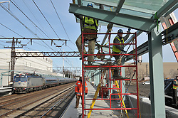 Installing Platform Canopy Glass. Fairfield Metro Commuter Rail Station, Fairfield, CT