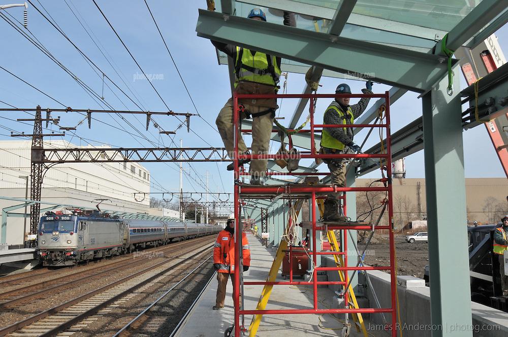 Installing Platform Canopy Glass. Fairfield Metro Commuter Rail Station, Fairfield, CT