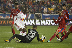 March 1, 2018 - Harrison, New Jersey, United States - Club Deportivo Olimpia Goalkeeper DONIS ESCOBER (28) stops an attempt on gaol by New York Red Bulls forward BRADLEY WRIGHT-PHILLIPS (99) during the CONCACAF Champions league match at Red Bull Arena in Harrison, NJ.  NY Red Bulls defeat CD Olimpia 2-0  (Credit Image: © Mark Smith via ZUMA Wire)