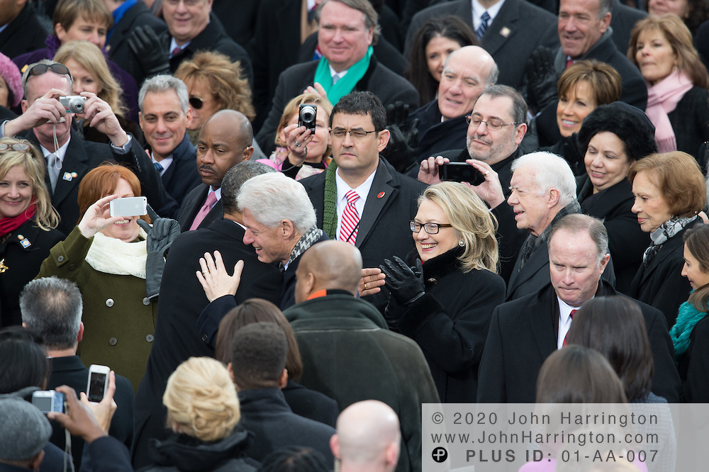 President Obama is greeted by former President Bill Clinton and Hillary Clinton as Chicago Mayor Rahm Emmanuel looks on at the 57th Presidential Inauguration of President Barack Obama at the U.S. Capitol Building in Washington, DC January 21, 2013.