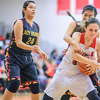 Grants Pirate Chali Simpson (2) right, tears possession away from Santa Fe Indian Brave Alliyah Coriz (10) at the Grants Invitational girls basketball tournament at Grants High School Friday.