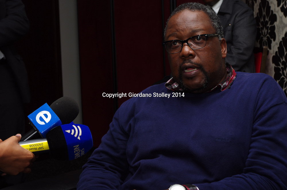 DURBAN - 11 November 2014 - South African police minister Nkosinathi Nhleko answers journalists questions surrounding the police investigations into security improvements at President Jcob Zuma's personal residence in Nkandla. Nhleko was attending a conference of the Civilian Secretariat for Police when he was confronted by journalists over the investigations into the Nkandla upgrades. Police have been forced to investigate after oppoistion parties filed corruption charges with the police. Picture: Allied Picture Press/APP