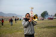 02 junio 2021, Tultepec, Estado de México. Trombonista toca una celebracción a san Juan de Dios.