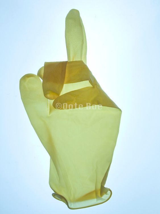 rubber glove with an up yours gesture