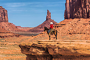 Classic Cowboy on John Ford's Scenic Point in Monument Valley Arizona