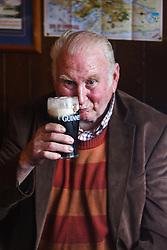 Man drinking pint of Guinness in Gaynor's Pub, Leenaun, County Galway, Ireland
