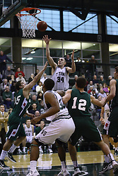 17 December 2011: John Koschnitzky takes a short jumper during an NCAA mens division 3 basketball game between the Washington University Bears and the Illinois Wesleyan Titans in Shirk Center, Bloomington IL