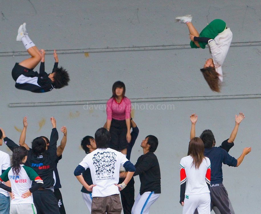 "This was a surprise - instead of just  ""hanging out"" on the weekends, young taiwanese acrobats throw each other up in the air in the Peace Park, Taipei- and no safety net!.. city"