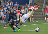 Sporting Kansas City forward Gianluca Busio (10) trips up Los Angeles FC midfielder Eduard Atuesta (20) during the second half at Children's Mercy Park.