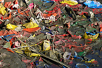 Plastic and paper Rubbish  rubbish on the riverbank
