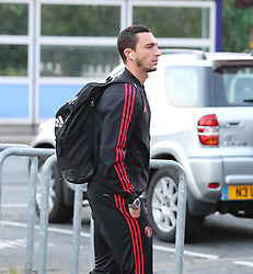 Manchester United's Matteo Darmian gets off the train at Wilmslow Station after their defeat to West Ham United