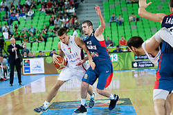 Bogdan Bogdanovic #7 of Serbia vs Nando De Colo #12 of France during basketball match between National teams of France and Serbia in 2nd Round at Day 12 of Eurobasket 2013 on September 14, 2013 in SRC Stozice, Ljubljana, Slovenia. (Photo By Urban Urbanc / Sportida)