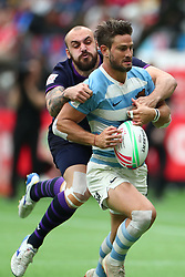 March 9, 2019 - Vancouver, BC, U.S. - VANCOUVER, BC - MARCH 09:  Maximo Provenzano (4) of Argentina runs the ball and attempts to avoid the tackle of Sam Pecqueur (9) of Scotland during day 1 of the 2019 Canada Sevens Rugby Tournament on March 9, 2019 at BC Place in Vancouver, British Columbia, Canada. (Photo by Devin Manky/Icon Sportswire) (Credit Image: © Devin Manky/Icon SMI via ZUMA Press)