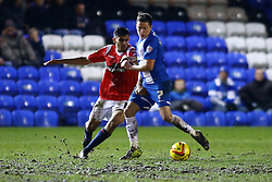 Peterborough United's Danny Swanson in action with Walsall's Malvind Benning - Photo mandatory by-line: Joe Dent/JMP - Tel: Mobile: 07966 386802 14/02/2014 - SPORT - FOOTBALL - Peterborough - London Road Stadium - Peterborough United v Walsall - Sky Bet League One