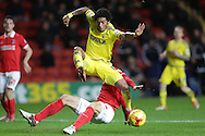 Harry Lennon of Charlton Athletic tackles Ryan Mendes of Nottingham Forest (c). Skybet football league championship match, Charlton Athletic v Nottingham Forest at The Valley  in London on Saturday 2nd January 2016.<br /> pic by John Patrick Fletcher, Andrew Orchard sports photography.