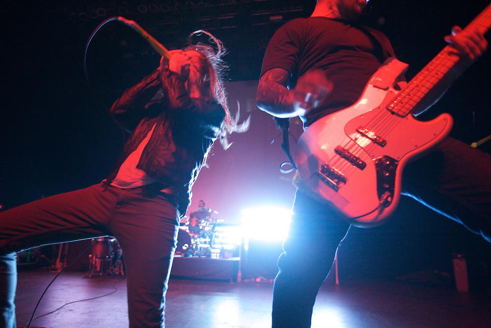 Underoath lead singer Spencer Chamberlain, left, and bassist Grant Brandell, right, perform at Terminal 5 in Manhattan, Thursday, February 17, 2011.