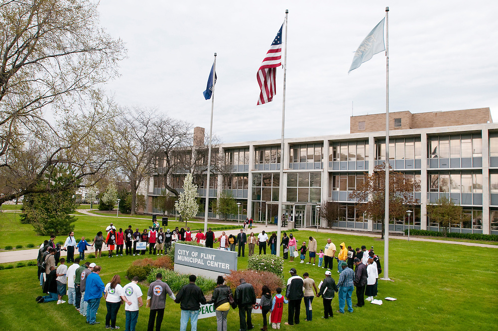 Matt Dixon   The Flint Journal..Demonstrators gather around Flint City Hall to pray at the end of an anti-violence rally Monday evening.