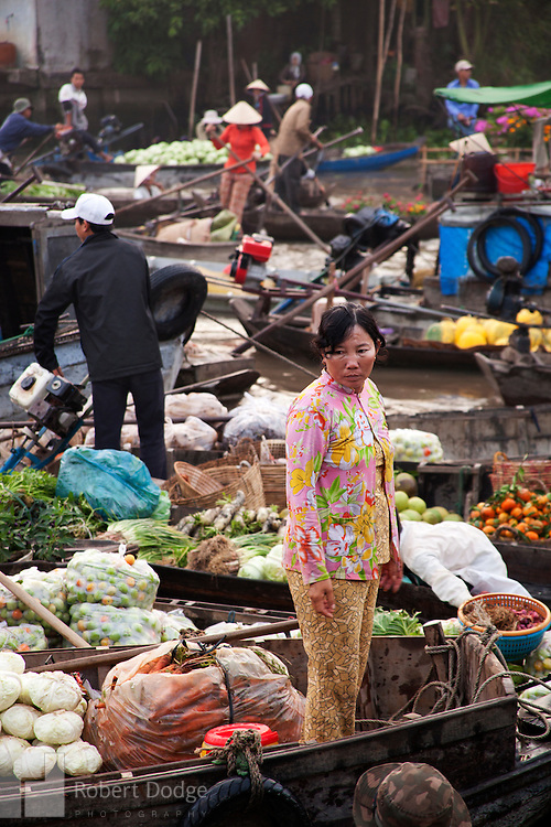 Robert Dodge, a Washington DC photographer and writer, has been working on his Vietnam Unexpected project since 2005. The project has taken him throughout Vietnam, including Hanoi, Ho Chi Minh City (Saigon), Nha Trang, Mue Nie, Phan Thiet, the Mekong, Sapa, Ninh Binh and the Perfume Pagoda. His images capture scenes and people from women in conical hats planting rice along the Red River in the north to men and women working in the floating markets one the Mekong River and its tributaries. Robert's project also captures the traditions of ancient Asia in the rural markets, Buddhist Monasteries and the celebrations around Tet, the Lunar New Year. Also to be found are images of the emerging modern Vietnam, such as young people eating and drinking and embracing the fashions and music of the west. Robert Dodge, a Washington DC photographer and writer, has been working on his Vietnam Unexpected project since 2005. The project has taken him throughout Vietnam, including Hanoi, Ho Chi Minh City (Saigon), Nha Trang, Mue Nie, Phan Thiet, the Mekong, Sapa, Ninh Binh and the Perfume Pagoda. His images capture scenes and people from women in conical hats planting rice along the Red River in the north to men and women working in the floating markets one the Mekong River and its tributaries. Robert's project also captures the traditions of ancient Asia in the rural markets, Buddhist Monasteries and the celebrations around Tet, the Lunar New Year. Also to be found are images of the emerging modern Vietnam, such as young people eating and drinking and embracing the fashions and music of the west.