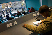 Young man studies at workstation in communal area at London Metropilitan University's Holloway Road campus. The male taps numbers on a calculator while others lounge around in the background. London Metropolitan University is one of the foremost providers of undergraduate, postgraduate, professional and vocational education and training in Britain. Their courses are planned in consultation with employers and examining bodies in commerce, industry, the world of art and design, the financial services industries and other professions. To compare profiles, Oxford University has the lowest proportion of working-class students, with 11.5%. London Metropolitan University has the greatest proportion, with 57.2%. The first building, designed by Charles Bell, was opened in 1896.