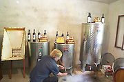 Durovic Jovo, the winemaker, taking a sample in the winery with stainless steel tanks. Durovic Jovo Winery, Dupilo village, wine region south of Podgorica. Vukovici Durovic Jovo Winery near Dupilo. Montenegro, Balkan, Europe.