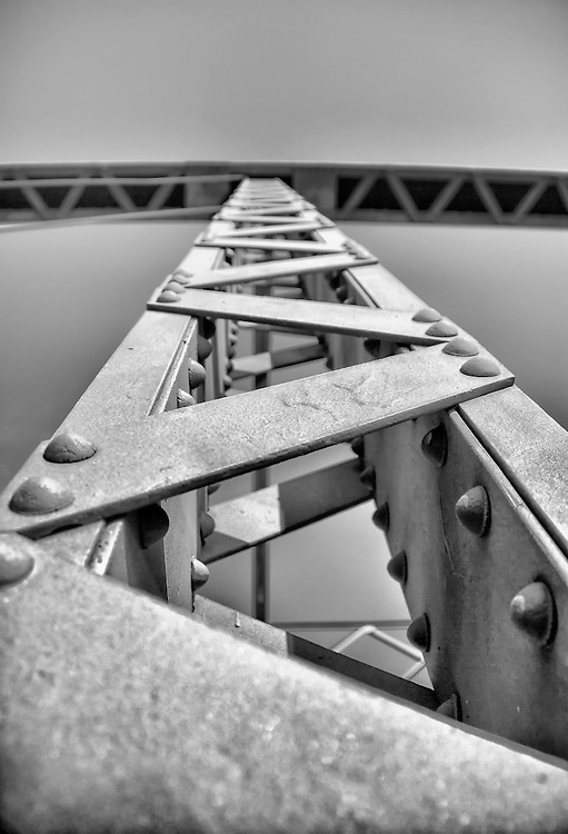 A supporting Iron Girder on a Bridge in Minnesota. Shot from an abstract perspective with revealing aged details in black and white