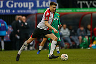 Woking defender Jack Cook (4) on the ball during the The FA Cup 3rd round match between Woking and Watford at the Kingfield Stadium, Woking, United Kingdom on 6 January 2019.