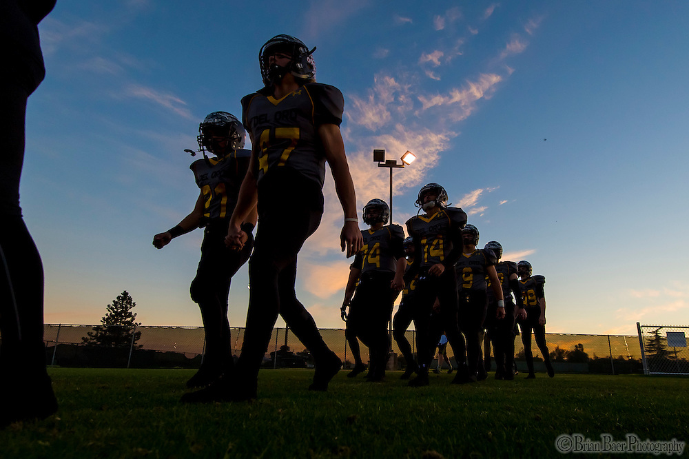 Members of the Del Oro Golden Eagle's walk to the field for warm ups before the game as the Del Oro Golden Eagles varsity football team host the Oak Ridge Trojans, Friday Oct 21, 2016.<br /> photo by Brian Baer