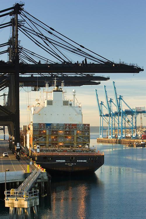 Cranes and container ship at Port of Tacoma, Tacoma, Washington, United States