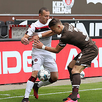 nph00001  17.05.2020 --- Fussball --- Saison 2019 2020 --- 2. Fussball - Bundesliga --- 26. Spieltag: FC Sankt Pauli - 1. FC Nürnberg ---  DFL regulations prohibit any use of photographs as image sequences and/or quasi-video - Only for editorial use ! --- <br /> <br /> Adam Zrelak (11, 1. FC Nürnberg ) Leo Östigard Oestigard (3, FC St. Pauli ) <br /> <br /> Foto: Daniel Marr/Zink/Pool//via Kokenge/nordphoto