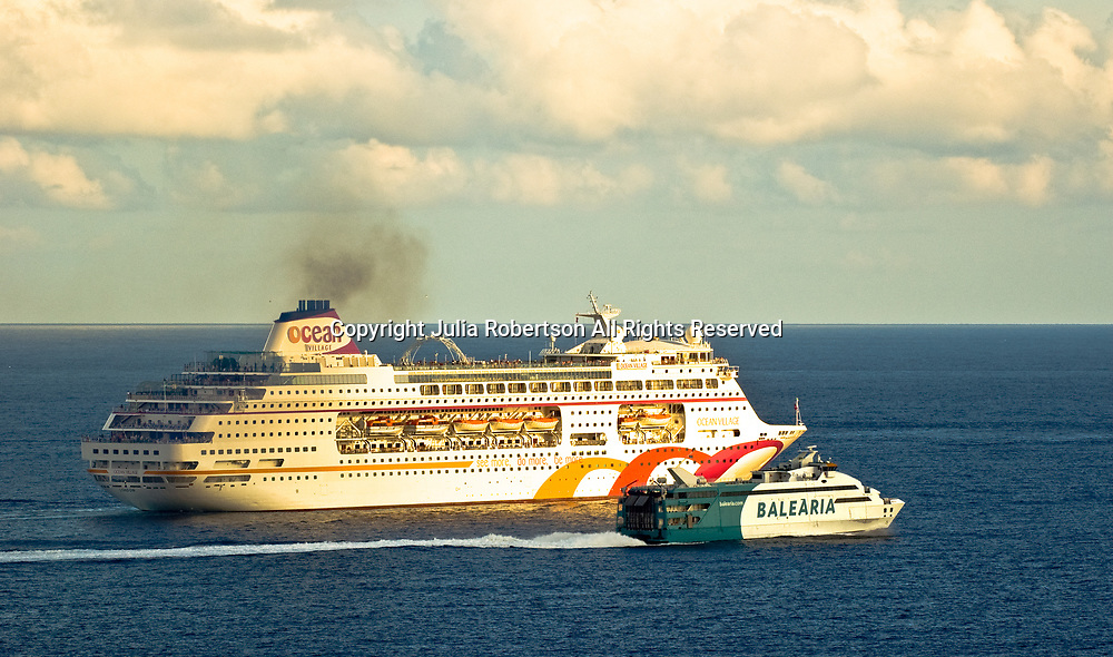 Aerial view of ocean Village Cruise Ship & Balearia Ferry just outside of Ibiza Spain