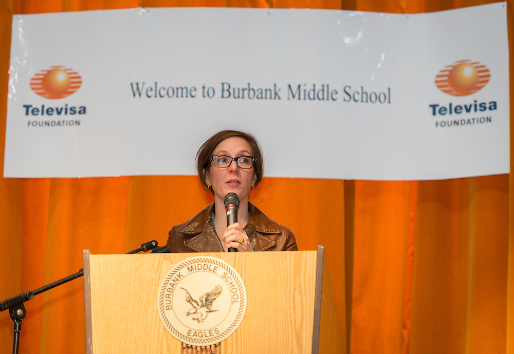 """Houston ISD Board of Education President Anna Eastman comments during a Televisa Foundation """"Live the Dream"""" event at Burbank Middle School, December 9, 2013."""