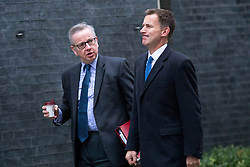 © Licensed to London News Pictures. 05/12/2017. London, UK. Environment, Food and Rural Affairs Secretary Michael Gove and Health Secretary Jeremy Hunt arriving in Downing Street to attend a Cabinet meeting this morning.Yesterday, Brexit negotiations on the Northern Ireland border were stalled when Arlene Foster of the DUP said she could not support commitment to keep Northern Ireland aligned with EU laws. Photo credit : Tom Nicholson/LNP