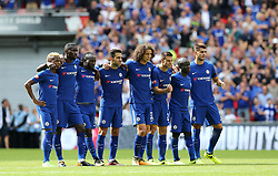 Left to right, Chelsea's Charly Musonda, Antonio Rudiger, Victor Moses, Cesc Fabregas, David Luiz, Cesar Azpilicueta, N'Golo Kante, Alvaro Morata watch the penalty shoot-out from the halfway line