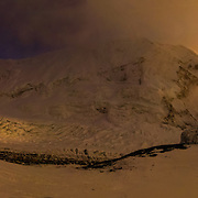 David Morton descends the West Ridge Headwall through ethereal light at sunset on Mount Everest, Nepal. Camp 2 and the Western Cwm lie below.<br /> <br /> To see the fullsize interactive panorama, please visit: http://www.gigapan.com/gigapans/152798.
