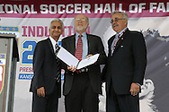 10 October 2013: Sportswriter George Vecsey (center) receives the Colin Jose Media Award from Sunil Gulati (left) and Hank Steinbrecher (right). The 2013 National Soccer Hall of Fame Induction Ceremony was held on the West Plaza outside Sporting Park in Kansas City, Kansas.