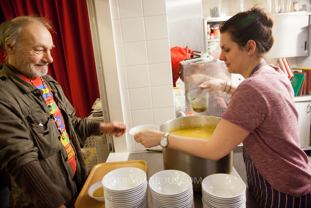 Roger, a volunter helps out serving the soup. North London Action for the Homeless cookes up a three course meal for a hundred homeless men and women in Stoke Newington, London. Every Monday luch time and Wednesday evening the charity serves up a hundred meals as well as a couple of hours of respite from the streets which in November are getting very cold and wet. All the food is donated and sourced locally and most of the staff are volunteers and have been with the charity for years.
