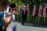 """President Donald Trump gestures to the audience as he arrives during a """"Celebration of America"""" event on the South Lawn of the White House on June 5, 2018 in Washington, DC. The celebration is being staged as a replacement for a White House visit by the Super Bowl champion Philadelphia Eagles. Some of the team was planning on boycotting the event due to the President's stance on players kneeling during the National Anthem at NFL games, so Trump resented their invitation.      Photo by Pete Marovich/UPI"""