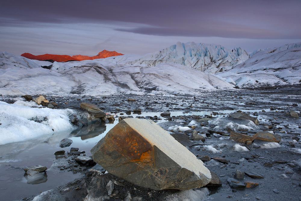 USA, Alaska, Chugach National Forest, Boulders & seracs on the tongue of the Matanuska Glacier at sunset