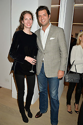 PRINCE CASIMIR ZU SAYN-WITTGENSTEIN-SAYN and his sister PRINCESS SOFIA ZU SAYN-WITTGENSTEIN-SAYN at an evening of Fashion, Art & design hosted by Ralph Lauren and Phillips at the new Phillips Gallery, 50 Berkeley Square, London on 22nd October 2014.