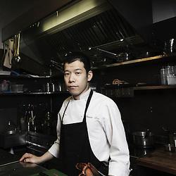 "PARIS, FRANCE. DECEMBER 1st, 2010. ""Passage 53"" Restaurant's chef Shinichi Sato in his kichen. (Photo by Antoine Doyen)"