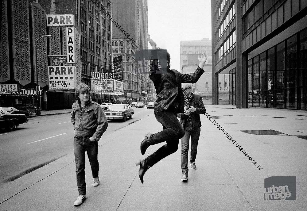 Photograph of U2 - Larry Mullen, Bono and Adam Clayton on USA tour day off 1981 Chicago  USA