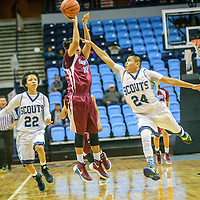 Window Rock Scout Keshaun Wililams (22), left, chases  Ganado Hornet William Curley (22) as he fires a shot at the end of the first quarter under pressure by Scout Tyrell Begay (24) during the Tournament of Champions at the Window Rock Scout Event Center in Fort Defiance Wednesday