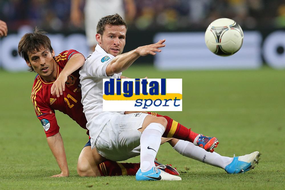 FOOTBALL - UEFA EURO 2012 - DONETSK - UKRAINE  - 1/4 FINAL - SPAIN v FRANCE - 23/06/2012 - PHOTO PHILIPPE LAURENSON /  DPPI - DAVID SILVA (ESP) / YOHAN CABAYE (FRA)