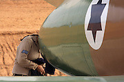 Israeli Air force Technician working on a jet engine