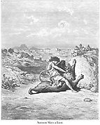 Samson Slaying a Lion Judges 14:5-6 From the book 'Bible Gallery' Illustrated by Gustave Dore with Memoir of Dore and Descriptive Letter-press by Talbot W. Chambers D.D. Published by Cassell & Company Limited in London and simultaneously by Mame in Tours, France in 1866